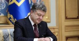 """بوروشينكو يصادق على قانون """"خدمة الأجانب"""" في صفوف الجيش الأوكراني"""