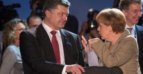 بوتن و ميركل خلال مؤتمر ميونخ