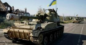أوكرانيا تنهي سحب أسلحتها من الشرق رغم الاشتباكات