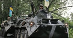 """أوكرانيا تتوعد باستخدام """"ترسانتها الكاملة"""" ضد المتمردين الموالين لروسيا"""
